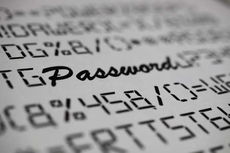 Close up of fictive letters and special characters with blurred word password, white background - complicated complex password change concept
