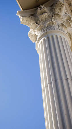 Close-up of a bright classical pillar on a bright, sunny day.