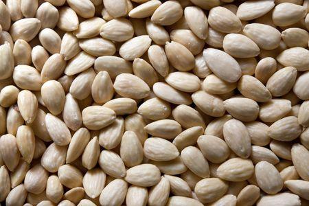 Background of raw blanched almonds: close up Reklamní fotografie