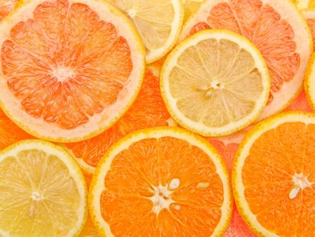 Close up on various citrus slices photo