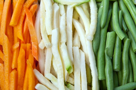 Background of julienne vegetables:  green beans, baby marrows and carrots Reklamní fotografie