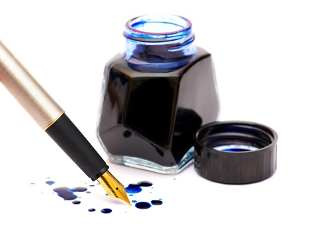 ink pot: The isolated dark blue ink, drops and gold pen