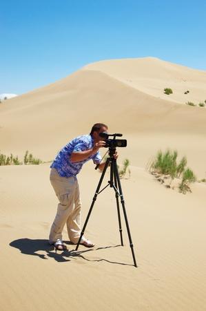 Video shooting in hot desert Stockfoto