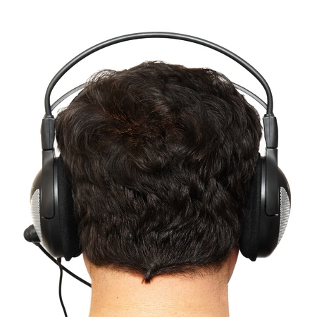 Man the brunette in ear-phones, the rear view. Stock Photo - 8929800