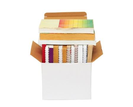 Open cardboard box with books Stockfoto