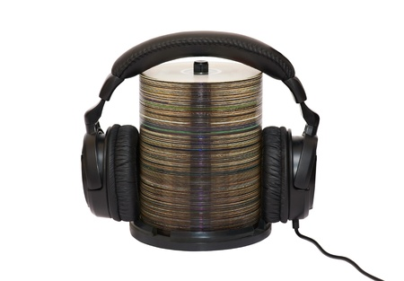 Stack of CDs with headphones photo
