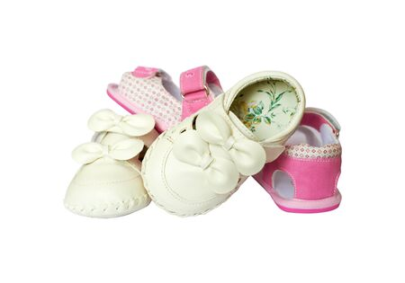 Pink end white  baby girl little shoes with laces isolated on the white background photo