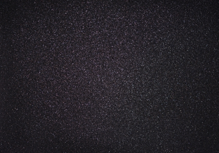 Texture of black foam with glitter photo
