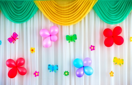 Festive curtain with balloons and butterflies photo