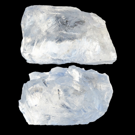 Two large pieces of ice on a black