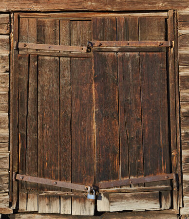 Old brown wooden door with old lock
