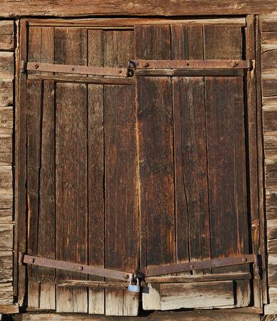 Old brown wooden door with old lock