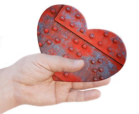 Iron heart in hand