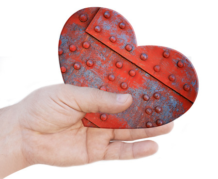 Iron heart in hand