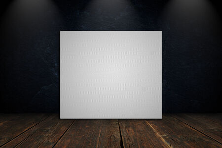 Blank canvas on a concrete wall