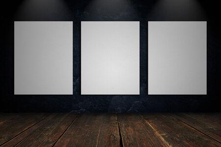 blank canvas: Three blank canvas on a concrete wall