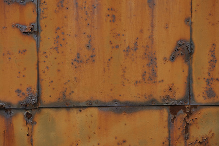 Rusty metal plate, brown with cracks