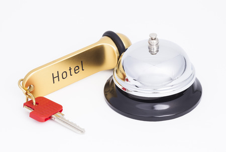 key ring: Hotel key and reception bell Stock Photo