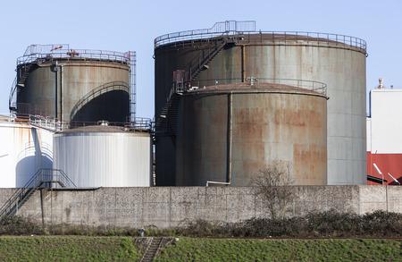 buildup: Image shows an buildup with fuel storage tanks