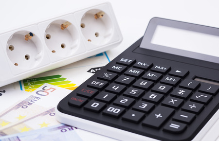 The image shows a power socket money and a calculator photo