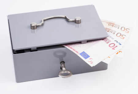 finacial: Cash box with euro banknotes isolated on white background Stock Photo