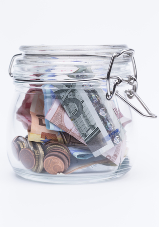 preserving: Image shows a preserving bottle with money