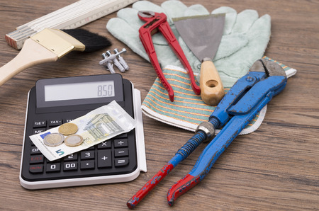 underpaid: Image shows some tools from a craftman and the salery Stock Photo