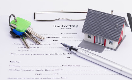 Real estate contract with house, pen and keys, isolated on white background photo