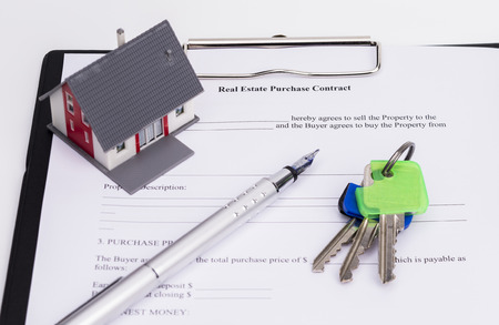 underwrite: Real estate contract with house, pen and keys, isolated on white background Stock Photo