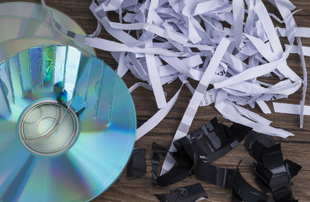 Image shows paper shavings, tape shred and compact disks