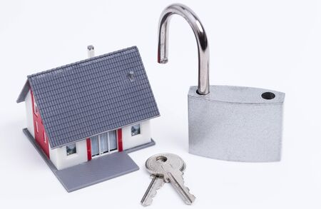 minature: Image shows a minature house with an open padlock Stock Photo