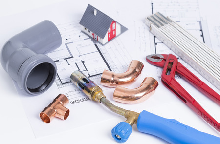 blowpipe: Image shows some plumbing tools Arranged on House Plans