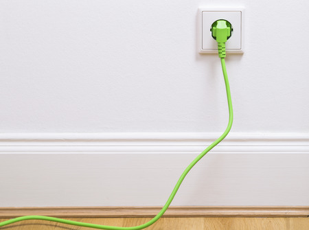 plugged in: Interior outlet with a green plugged in cable