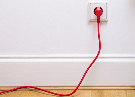 europe: Interior outlet with a red cable plugged in