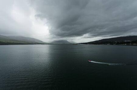 waterskiing: Scenic view of sea bay, Akureyri at Iceland Stock Photo