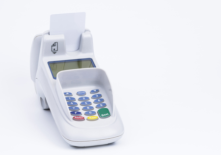 ec: Image shows a credit card machine isolated on white Stock Photo
