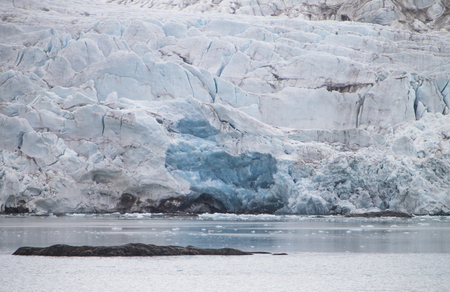 Dying glacier in Monacobreen,Spitsbergen at midsummer