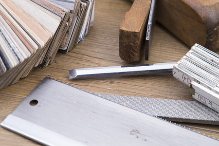 inlay: Tools and samples of inlay on wooden table Stock Photo