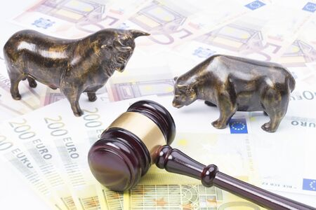 The image shows a bull and a bear standing on a few bank notes with Judge's Hammer