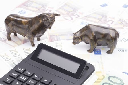 The image shows bull and bear on a banknotes Standard-Bild
