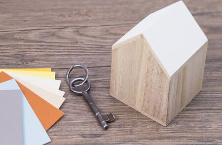 The photo shows a wooden house with color guides and keys