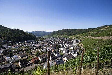 The image shows a panoramic view over the small town of Dernau in Germany