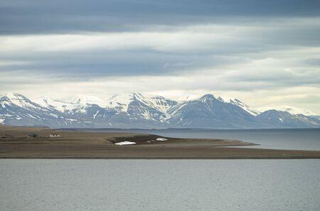 The photo shows an empty village on Spitsbergen