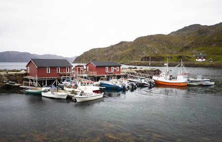 A small harbor with Fishing and sports boats in Northern Norway Standard-Bild