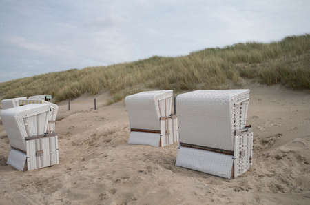 The photo shows several beach chairs in the dunes Standard-Bild