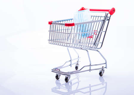 A shopping trolley with a protective mask