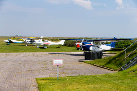 Baltrumer airfield with parked aircraft in daylight
