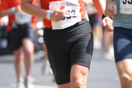 Detail of a marathon runner in full action during the Dusseldorf marathon, Germany photo