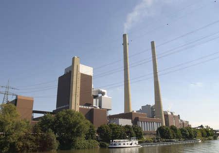 coal firing power plant under a clear blue sky photo