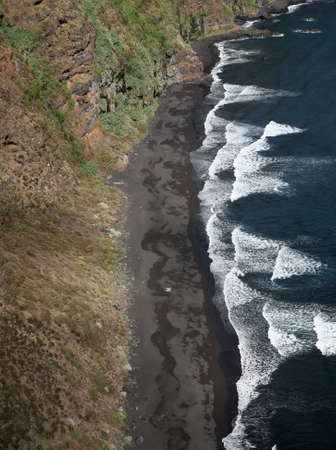 bird s eye: bird s eye view of a lonely and remote beach on a volcanic island Stock Photo